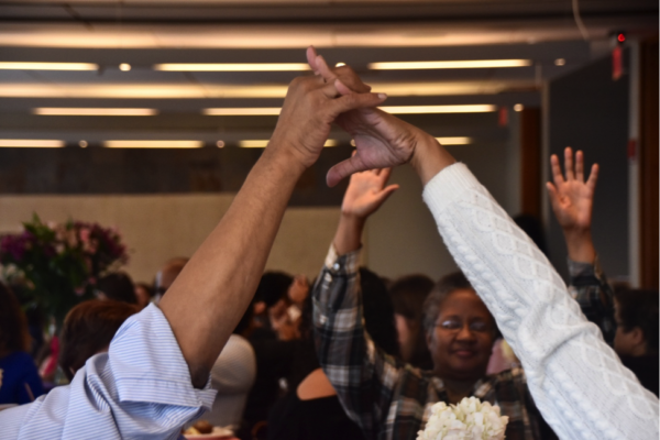 Attendees Hands in the Air. The 18th Annual Audre Lorde Cancer Awareness Brunch Program. 2016.
