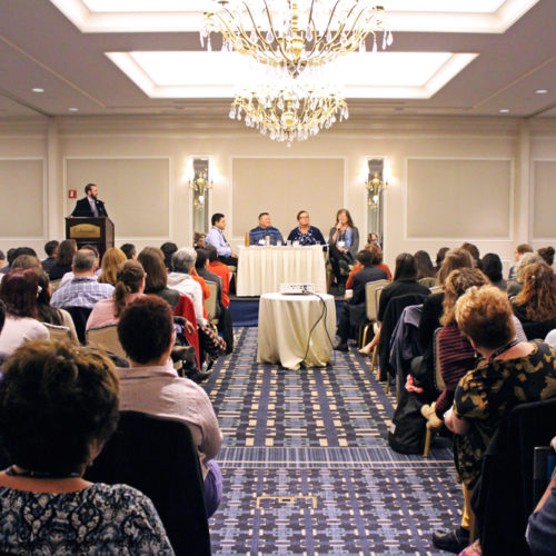 Photo of speakers and audience at 2017 Advancing Excellence in Transgender Health Conference