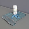 Photo of a Truvada bottle with pills on a pill counting tray