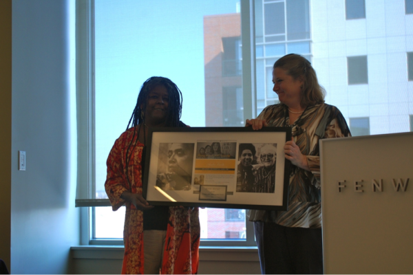 Denise Bentley (left), Founder of the Audre Lorde Cancer Awareness Brunch, accepting an award from Bonnie McFarlane (right). 2012.